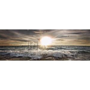 Niels Busch - Sun shining over rocky waves
