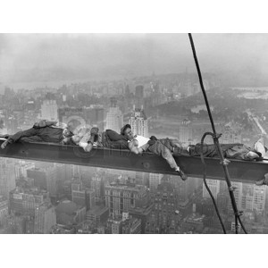 Anonymous - Construction Workers Resting on Steel Beam Above Manhattan, 1932